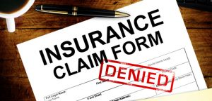 insurance claim form with denied stamp